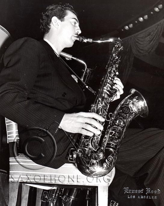 "Bus Bassey, featured tenor sax with Artie Shaw, enjoys the distinction of owning the first ""padless"" saxophone sold anywhere in the United States"